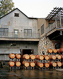 USA, California, an exterior of the Nevada City Winery and freshly filled wine barrels, Gold Country
