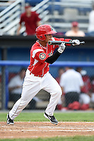 Batavia Muckdogs designated hitter Iramis Olivencia (7) attempts a bunt during a game against the Auburn Doubledays on June 16, 2014 at Dwyer Stadium in Batavia, New York.  Batavia defeated Auburn 4-3.  (Mike Janes/Four Seam Images)