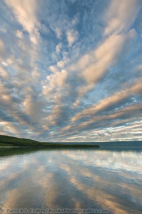 Sunrise and clouds over Naknek lake, Aleutian mountain range, Katmai National Park, Alaska.