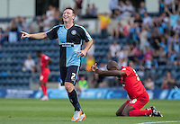 Joy and Pain as Garry Thompson of Wycombe Wanderers celebrates Stephane Zubar (right) of York City own goal during the Sky Bet League 2 match between Wycombe Wanderers and York City at Adams Park, High Wycombe, England on 8 August 2015. Photo by Andy Rowland.
