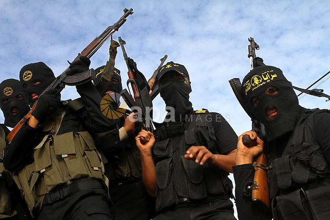 Palestinian militants from the Islamic Jihad group attend the funeral of their comrade Mohammed Najjar in Khan Younis in the southern Gaza Strip on January 12, 2011. A missile fired by an Israeli aircraft killed the Palestinian militant riding a motorcycle in the Gaza Strip close to the border with Israel on Tuesday, the Israeli army and the Islamic Jihad militant group said. Photo by Ashraf Amra