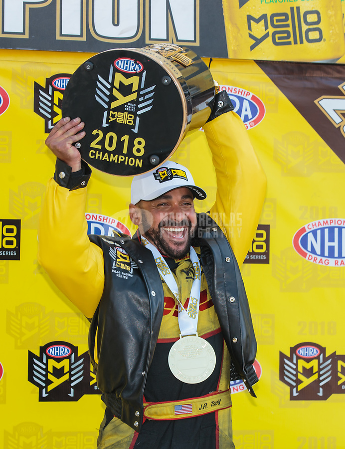 Nov 11, 2018; Pomona, CA, USA; NHRA funny car driver J.R. Todd celebrates after clinching the 2018 funny car world championship during the Auto Club Finals at Auto Club Raceway. Mandatory Credit: Mark J. Rebilas-USA TODAY Sports