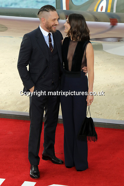 NON EXCLUSIVE PICTURE: MATRIXPICTURES.CO.UK<br /> PLEASE CREDIT ALL USES<br /> <br /> WORLD RIGHTS<br /> <br /> English actor Tom Hardy and English actress Charlotte Riley attend the World Premiere of Dunkirk at Odeon Leicester Square in London.<br /> <br /> JULY 13th 2017<br /> <br /> REF: MES 171540