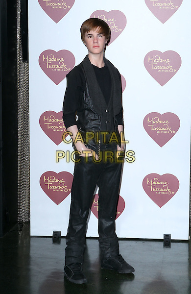 25 January 2012 - Las Vegas, Nevada - Justin Bieber Figure.Madame Tussauds Las Vegas unveils Justin Bieber Wax Figure at The Venetian, Las Vegas, Nevada, USA..January 25th, 2012.work waxwork full length black jeans denim shirt waistcoat hand in pockets .CAP/ADM/MJT.© MJT/AdMedia/Capital Pictures.