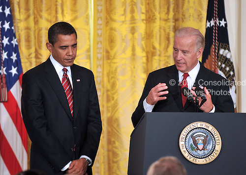 Washington, DC - January 30, 2009 -- United States Vice President Joseph Biden, right, makes remarks as he and United States President Barack Obama, left, announce Labor Executive Orders and the establshment of the Middle Class Working Families Task Force in the East Room of the White House in Washington, DC on Friday, January 30, 2009.  .Credit: Ron Sachs - CNP