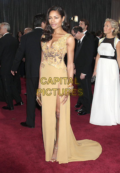Naomie Harris.85th Annual Academy Awards held at the Dolby Theatre at Hollywood & Highland Center, Hollywood, California, USA..February 24th, 2013.oscars full length gold dress peplum pattern skirt slit split side bracelet .CAP/ADM/RE.©Russ Elliot/AdMedia/Capital Pictures.