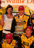 Oct 4, 2008; Talladega, AL, USA; NASCAR Craftsman Truck Series driver Todd Bodine (top right) celebrates after winning the Mountain Dew 250 at the Talladega Superspeedway. Mandatory Credit: Mark J. Rebilas-