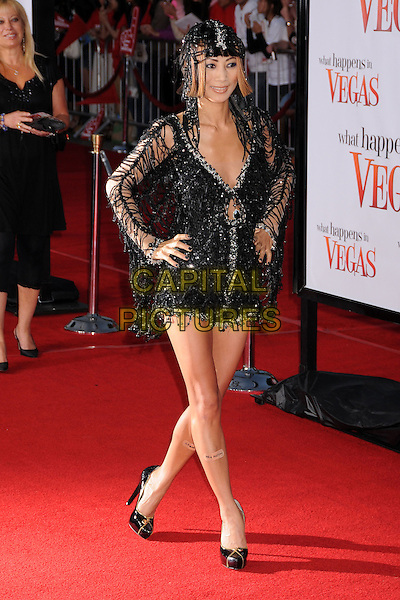 "BAI LING.""What Happens in Vegas"" Los Angeles Premiere at Mann's Village Theatre, Westwood, California, USA..May 1st, 2008.full length black beads beaded dress slash spider web shoes hat silver hands on hips plasters bandages calves legs .CAP/ADM/BP.©Byron Purvis/AdMedia/Capital Pictures."