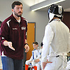 Garden City fencing coach Kevin Oliver, left, chats with Matthew Quigley of Garden City during a meet against Great Neck South at Garden City High School on Saturday, Jan. 9, 2016.