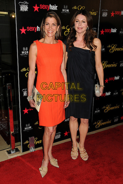 Wendie Malick, Jane Leeves.Alliance For Women In Media Foundation's 37th Annual Gracie Awards Gala held at the Beverly Hilton Hotel, Beverly Hills, California, USA..May 22nd, 2012.full length black orange dress one shoulder .CAP/ADM/BP.©Byron Purvis/AdMedia/Capital Pictures.