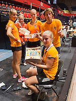 The Netherlands, Den Bosch, 16.04.2014. Fed Cup Netherlands-Japan, practice, Richel Hogenkamp receives a birthday cake from Arantxa Rus (L) (NED), Michaela Krajicek (NED, Kiki Bertens (NED) , ) and captain Paul Haarhuis  (NED)<br /> Photo:Tennisimages/Henk Koster