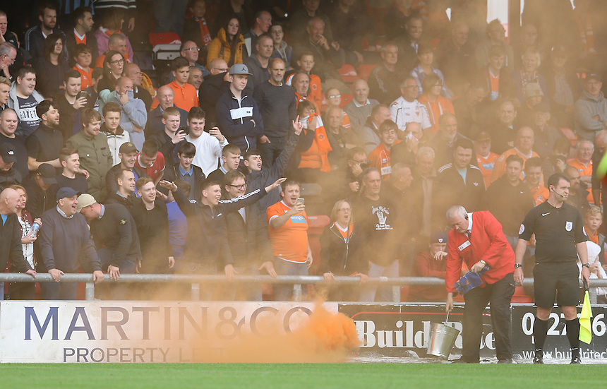 A steward deals with a flare set off by Blackpool fans <br /> <br /> Photographer Stephen White/CameraSport<br /> <br /> The EFL Sky Bet League Two - Crewe Alexandra v Blackpool - Saturday 24th September 2016 - Alexandra Stadium - Crewe<br /> <br /> World Copyright &copy; 2016 CameraSport. All rights reserved. 43 Linden Ave. Countesthorpe. Leicester. England. LE8 5PG - Tel: +44 (0) 116 277 4147 - admin@camerasport.com - www.camerasport.com