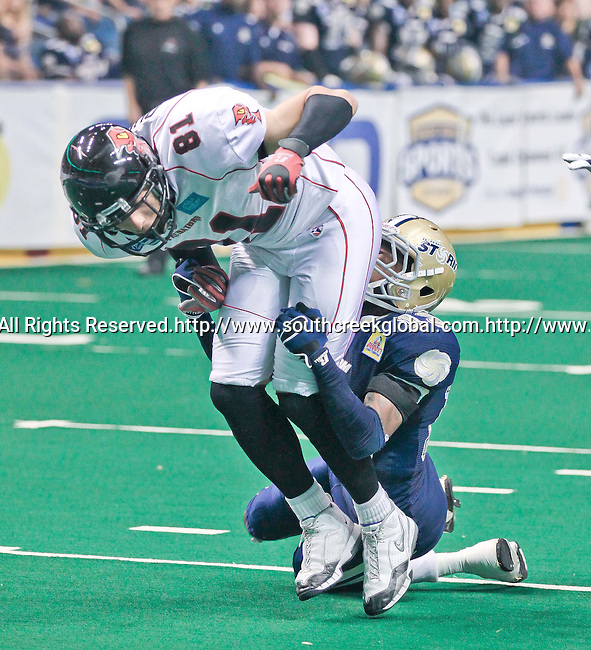 Aug 14, 2010: Tampa Bay Storm wide receiver DeAndrew Rubin (#13) brings down linebacker Robert Quiroga (#81). The Storm defeated the Predators 63-62 to win the division title at the St. Petersburg Times Forum in Tampa, Florida. (Mandatory Credit:  Margaret Bowles)