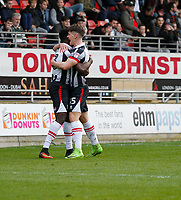 Grimsby Town's Akwasi Asante is congratulated by Sam Jones (R) during the Sky Bet League 2 match between Leyton Orient and Grimsby Town at the Matchroom Stadium, London, England on 11 March 2017. Photo by Carlton Myrie / PRiME Media Images.