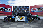 Allan Westerholt poses for a photo with a NASCAR race car with the Wake Forest logo on the driver's side door at the Charlotte Motor Speedway on December 26, 2017 in Concord, North Carolina.  (Brian Westerholt/Sports On Film)