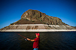 ELEPHANT BUTTE, NM - APRIL 9, 2015:  Johnny Baca fishes on the low Elephant Butte Reservoir. The reservoir dams the Rio Grande River and at the time it was completed in 1916, it was the largest irrigation reservoir in the world. CREDIT: Max Whittaker for The New York Times