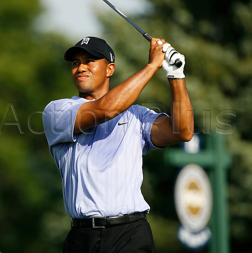 13 August 2009:  Tiger Woods hits a shot during the first round of the 91st PGA Championship at Hazeltine National Golf Club in Chaska, Minnesota. (photo Charles Baus/Actionplus)
