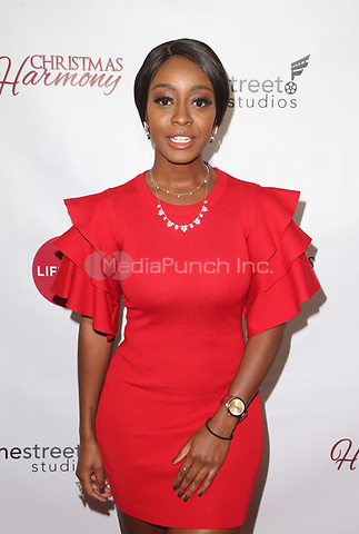 """LOS ANGELES, CA - NOVEMBER 7: Jessica Obilom, at Premiere of Lifetime's """"Christmas Harmony"""" at Harmony Gold Theatre in Los Angeles, California on November 7, 2018. Credit: Faye Sadou/MediaPunch"""