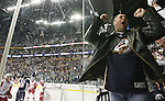 Country singer Vince Gill celebrates as the Nashville Predators score a goal against the Detroit Red Wings at the Sommet Center on Wednesday, April 16, 2008. The Predators defeated the Red Wings 3-2. (Photo by Frederick Breedon)