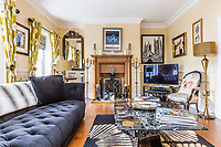 BNPS.co.uk (01202 558833)<br /> Pic: Rightmove/BNPS<br /> <br /> One of the sitting rooms<br /> <br /> A period property halfway up one of England's steepest hills is not a home for the faint-hearted.<br /> <br /> The buyer of this house - on the market for £975,000 - will need to be an energetic fitness fan to face the tough slog up the aptly named Steep Hill; the fourth steepest street in the country.<br /> <br /> The Grade II Listed townhouse is on Christs Hospital Terrace in Lincoln, a quaint cobbled street that branches off Steep Hill.<br /> <br /> The road has an unusually severe 16.12-degree gradient, making it one of the steepest residential streets in England, according to the Ordnance Survey.