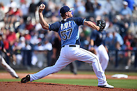 Tampa Bay Rays pitcher Jake McGee (57) during a spring training game against the Boston Red Sox on March 25, 2014 at Charlotte Sports Park in Port Charlotte, Florida.  (Mike Janes/Four Seam Images)