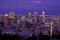AJ0803, Canada, Quebec, Montreal, Aerial of the downtown skyline of Montreal from Mount Royal illuminated in the evening.