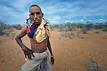 A Somali man treks across eastern Kenya near the Somali border. He left his home a month earlier, fleeing drought and conflict, and heading to the Dadaab refugee complex. Already the world's world's largest refugee settlement, Dadaab has swelled in recent weeks with tens of thousands of recent arrivals from Somalia.