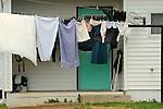 Clothesline on Amish farm porch.