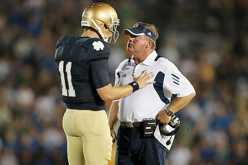 Notre Dame quarterback Tommy Rees (#11) explains his case to head coach Brian Kelly during NCAA football game between Notre Dame and South Florida.  The South Florida Bulls defeated the Notre Dame Fighting Irish 23-20 in game at Notre Dame Stadium in South Bend, Indiana.