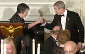 U.S. President George W. Bush (R) toasts Arizona Gov. Janet Napolitano, who is the chairperson for the National Governor's Association, at a State Dinner in honor of the nation's governors, February 25, 2007 at the White House in Washington.     pool photo by Mike Theiler/EPA