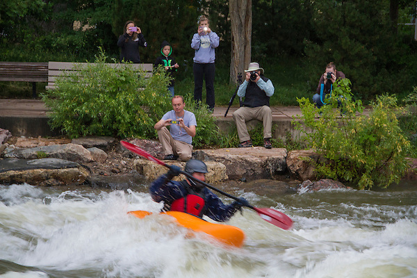Photographers and kayaker in Clear Creek, Golden, Colorado,