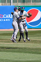 Cedar Rapids Kernels outfielders Zach Granite (1), Zack Larson (24) and Max Murphy (13) celebrate a victory during a game against the Wisconsin Timber Rattlers on April 23rd, 2015 at Fox Cities Stadium in Appleton, Wisconsin.  Cedar Rapids defeated Wisconsin 3-0.  (Brad Krause/Four Seam Images)