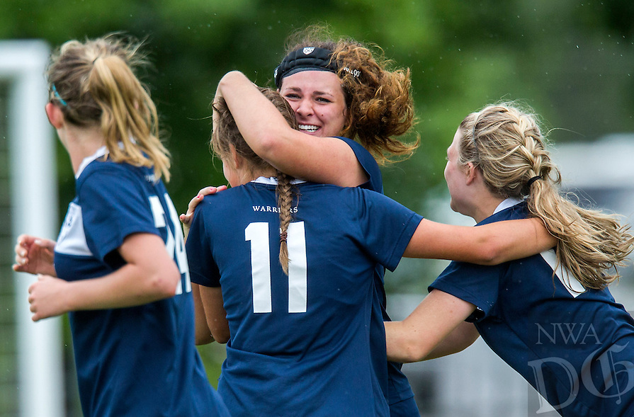 NWA Democrat-Gazette/JASON IVESTER --05/22/2015--<br /> Little Rock Christian players celebrate with senior Annalee Rhodes (second from left) following her game-winning goal against Pulaski Academy in the 5A championship game on Friday, May 22, 2015, at Razorback Field in Fayetteville.