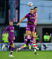 Lincoln City's Jason Shackell vies for possession with Carlisle United's Hallam Hope<br /> <br /> Photographer Chris Vaughan/CameraSport<br /> <br /> The Emirates FA Cup Second Round - Lincoln City v Carlisle United - Saturday 1st December 2018 - Sincil Bank - Lincoln<br />  <br /> World Copyright © 2018 CameraSport. All rights reserved. 43 Linden Ave. Countesthorpe. Leicester. England. LE8 5PG - Tel: +44 (0) 116 277 4147 - admin@camerasport.com - www.camerasport.com