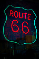 Route 66 Neon sign in store window in Williams Arizona.