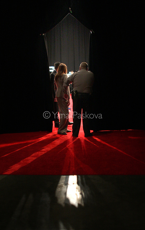 A security guard scans the spin room after the FOX News Republican debate ends on January 10, 2008, in Myrtle Beach, South Carolina. (Photo by: Yana Paskova for The New York Times)..Assignment ID: 30055282A.....