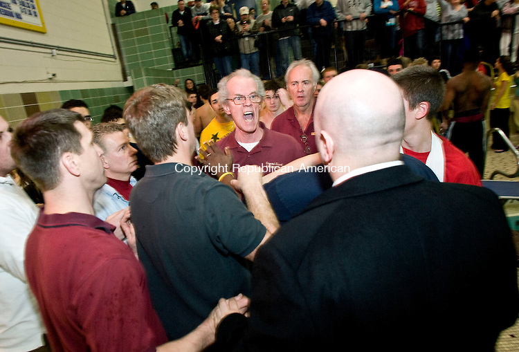 WATERBURY, CT - 29 JANUARY 2010 -012910JT04--<br /> Tempers were hot at the end of Friday's swim meet as Sacred Heart Assistant Coach Butch Savage exchanges words with Naugatuck's Athletic Director Tommy Pompei after Naugatuck narrowly won the meet at Kennedy High School.<br /> Josalee Thrift Republican-American