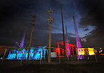 Big Spring partners and Huntsville Utilities working with Theatrical Lighting demonstrate a proof of concept in decorative LED lighting at the TVA substation near the Embassy Suites Hotel.  The lights, which constantly change will be up through Big Spring Jam.   Bob Gathany photo.