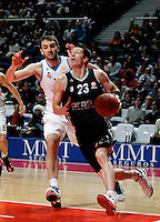 Real Madrid's Mirza Begic and Brose's Casey Jacobsen during Euroliga match. February 28,2013.(ALTERPHOTOS/Alconada)