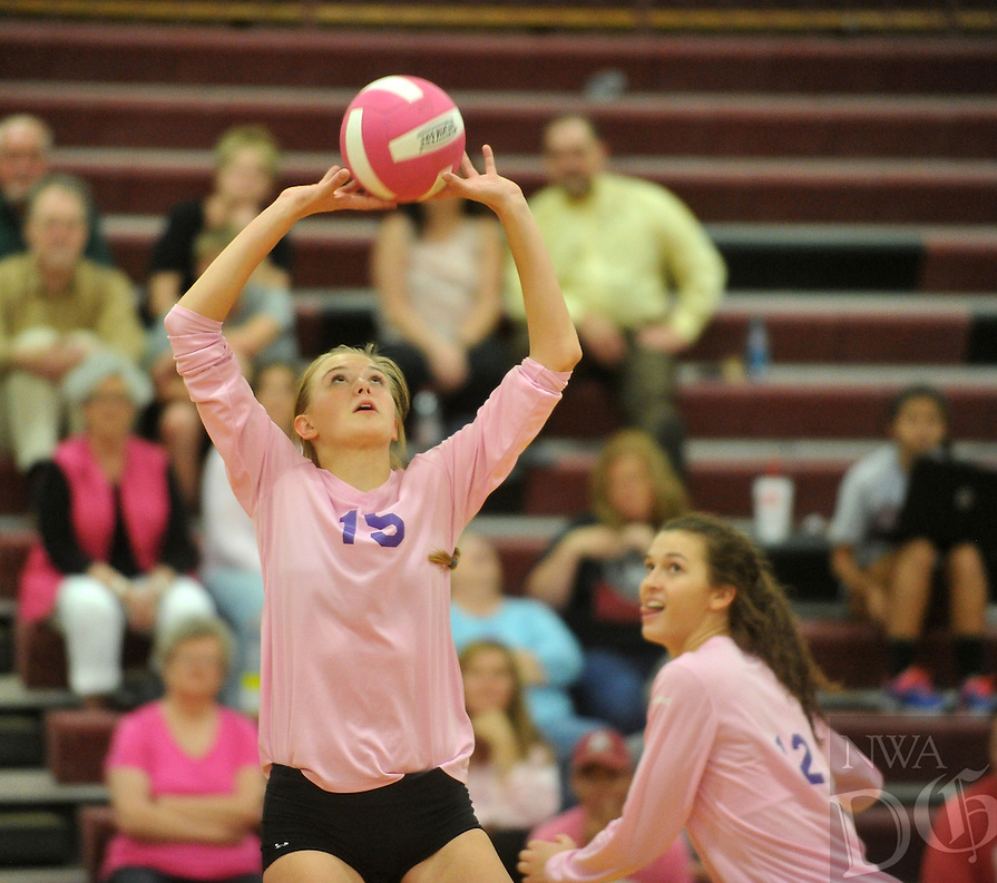 NWA Democrat-Gazette/MICHAEL WOODS &bull; @NWAMICHAELW<br /> Fayetteville High's Ella May Powell (15) sets up the ball for teammate Faith Waitsman (12) during their game against Springdale High School Tuesday October 13, 2015 in Springdale.