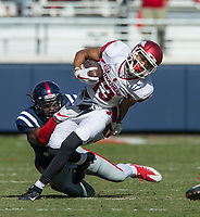 Hawgs Illustrated/BEN GOFF <br /> Deon Stewart (13), Arkansas wide receiver, breaks the tackle of Marquis Haynes, Ole Miss defensive end, in the fourth quarter Saturday, Oct. 28, 2017, at Vaught-Hemingway Stadium in Oxford, Miss.