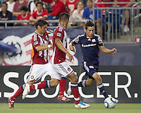 New England Revolution forward Diego Fagundez (14) on the attack. In a Major League Soccer (MLS) match, Chivas USA defeated the New England Revolution, 3-2, at Gillette Stadium on August 6, 2011.