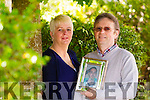 Olivia Foley Murphy and Pat Murphy with a photo of their late son Daniel Foley