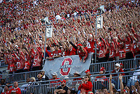 Ohio State students in the Block O section cheer during the Buckeyes' 38-0 win over Hawaii in the NCAA football game at Ohio Stadium in Columbus on Sept. 12, 2015. (Adam Cairns / The Columbus Dispatch)
