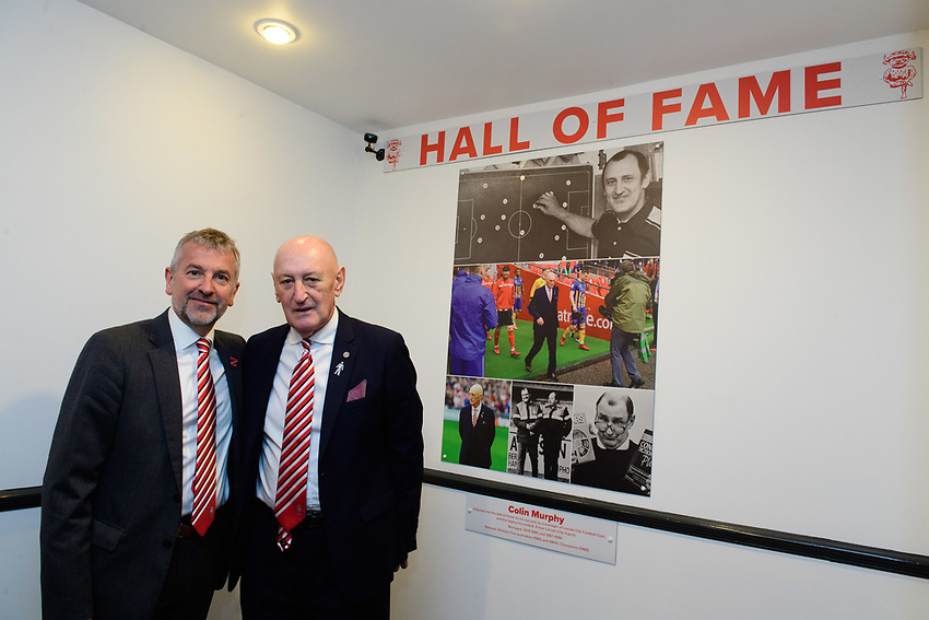 Lincoln City have inducted former manager Colin Murphy as the inaugural member of their Hall of Fame. Picutred is Lincoln City's vice-chairman Roger Bates, left, and Colin Murphy.<br /> <br /> Photographer Chris Vaughan/CameraSport<br /> <br /> The EFL Sky Bet League Two - Saturday 15th December 2018 - Lincoln City v Morecambe - Sincil Bank - Lincoln<br /> <br /> World Copyright © 2018 CameraSport. All rights reserved. 43 Linden Ave. Countesthorpe. Leicester. England. LE8 5PG - Tel: +44 (0) 116 277 4147 - admin@camerasport.com - www.camerasport.com