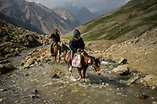 A Hindu pilgrim rides a pony along the Amarnath trekking route in Kashmir, India. Hindu pilgrims brave sub zero temperature and high latitude passes and make their pilgrimage to reach the sacred Amarnath cave, which houses a lingam - a stylized phallus, worshiped by Hindus as a symbol of God Shiva. Photo: Sanjit Das/Panos