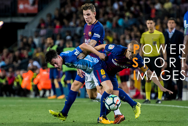 Juan Pablo Anor Acosta, Juanpi (l), of Malaga CF is tackled by Andres Iniesta Lujan (r) of FC Barcelona during the La Liga 2017-18 match between FC Barcelona and Malaga CF at Camp Nou on 21 October 2017 in Barcelona, Spain. Photo by Vicens Gimenez / Power Sport Images