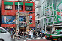 Young shoppers wait at the trendy Harajuku district of Tokyo, Japan. As Japan is seeing the light after over ten years of a stagnant economy public consumer spending is on the increase and areas like Harajuku are on the up with new shops and cafes opening and doing well..