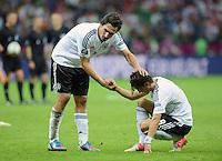 FUSSBALL  EUROPAMEISTERSCHAFT 2012   HALBFINALE Deutschland - Italien              28.06.2012 Mats Hummels (li) und Mesut Oezil (re, beide Deutschland) sind nach dem Abpfiff enttaeuscht
