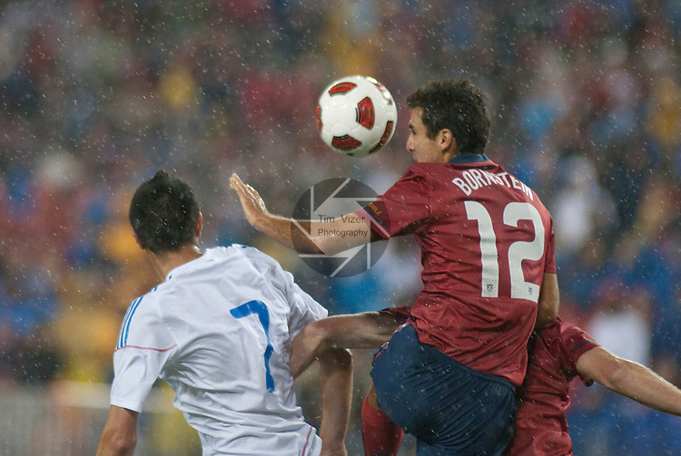 March 29,  2011     Paraguay forward Oscar Cardozo (7, left) and USA defender Jonathan Bornstein (12) jump for a head ball in the first half during a light rain.  The USA Men's National Soccer Team played Paraguay in an international friendly game on Tuesday March 29, 2011 at LP Field in Nashville, Tennessee.